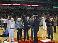 US Navy 021207-N-4664K-022 Rear Adm. D.C. Curtis from Chicago, Ill., Commander, Naval Surface Group Two, presented Chicago-area Pearl Harbor survivors with his command coin prior to the Chicago Bulls vs. Cleveland Cavaliers gam.jpg
