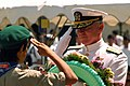 US Navy 040515-N-2101W-003 Commander U.S. Seventh Fleet, Vice Adm. Robert F. Willard, accepts a wreath from a Japanese Boy Scout before placing it at the memorial at Shimoda Park.jpg
