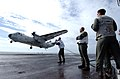 US Navy 040908-N-4308O-003 Landing Signal Officers (LSO) grade the arrested landing of a C-2A Greyhound.jpg