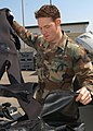 US Navy 050329-N-2385R-013 Information Systems Technician 2nd Class Joseph O'Brien, assigned to Explosive Ordnance Disposal Mobile Unit Five (EODMU-5), Detachment Five One, prepares to wash his dive gear to remove salt w.jpg