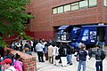US Navy 050615-N-6525H-083 Charlestown High School students wait in line for their turn to try the U.S. Navy Blue Angels F-A-18 Hornet simulator during Boston Navy Week, a week of Navy events and activities throughout the area.jpg