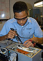 US Navy 051003-N-1126D-001 Aviation Electronics Technician Airman Jose Vasquez repairs a power supply at Aviation Intermediate Maintenance Department (AIMD) on board Naval Air Station Jacksonville.jpg