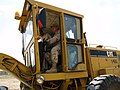US Navy 070707-N-3385W-086 U.S. Navy Cmdr. David Adams, commanding officer of Provincial Reconstruction Team Khost, drives a grader for the first few meters of a groundbreaking ceremony.jpg