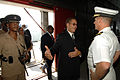 US Navy 070922-N-0989H-021 The Honorable Bruce Golding, Prime Minister to Jamaica, speaks with Capt. Douglas Wied, commander of Task Group 40.9, as he comes aboard High Speed Vessel (HSV) 2 Swift for a reception.jpg
