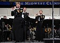 US Navy 071219-N-0773H-106 Master Chief Musician Betty R. Myers, left, Musician 1st Class Jennifer D. Smith, center and Chief Musician Luellyn K. Dollard play the piccolo with the Navy Band during The Stars and Stripes Forever.jpg