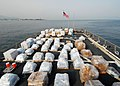 US Navy 080825-N-4044H-001 Pallets of supplies sit on the flight deck of the guided-missile destroyer USS McFaul (DDG 74).jpg