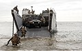 US Navy 081207-M-5633L-002 Marines assigned to Bravo Company, 1st Battalion, 13th Marine Expeditionary Unit (13th MEU) exit a landing craft utility while conducting a noncombatant evacuation operation scenario.jpg