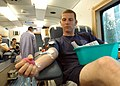US Navy 090212-N-6326B-011 Hospital Corpsman 2nd Glen Mulkey donates a blood sample in the Mobile Blood Bank at Naval Medical Center San Diego (NMCSD).jpg