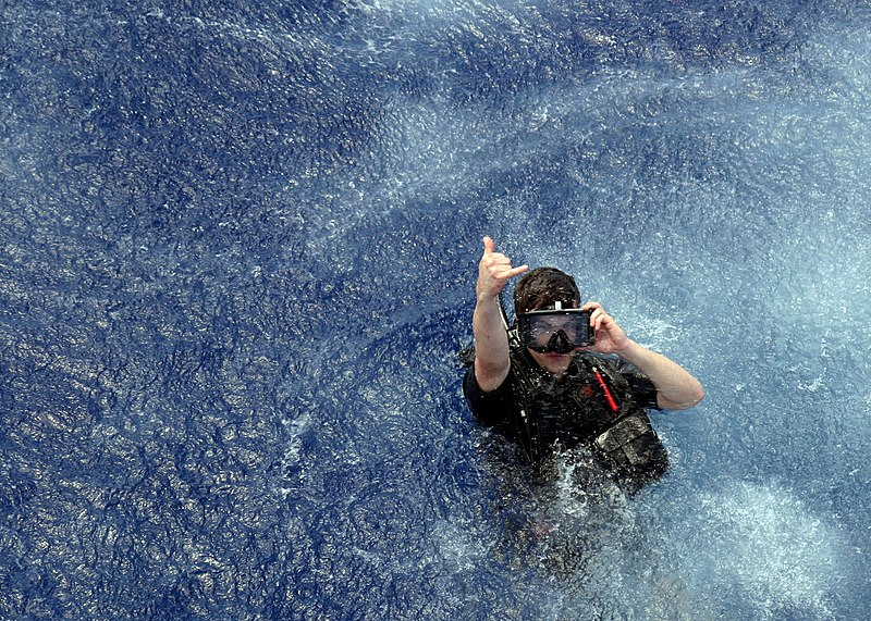 File:US Navy 090427-N-2354M-002 Aviation Warfare Systems Operator 3rd Class Owens signals that he has landed safely in the water during the search and rescue exercise portion of UNITAS Gold.jpg