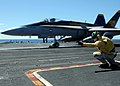 US Navy 090612-N-8534H-084 Lt. Marc Henderson, a Shooter aboard USS George Washington (CVN 73), gives the signal to launch an F-A-18C Hornet from the Golden Dragons, Strike Fighter Squadron (VFA) 192.jpg