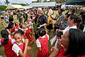 US Navy 090724-N-9689V-004 Royal New Zealand Navy Petty Officer Richard Boyd dances with school children during a Pacific Partnership 2009 community service project at Faleloa Primary School.jpg