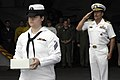 US Navy 090725-N-3038W-216 Capt Michael Manazir, commanding officer of the aircraft carrier USS Nimitz (CVN 68), renders a hand salute while Boatswain's Mate Seaman Tara Carpenter carries remains to be committed to the sea.jpg