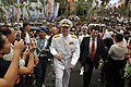 US Navy 090819-N-8273J-649 Chief of Naval Operations (CNO) Adm. Gary Roughead and U.S. Ambassador to Indonesia, the Honorable Cameron Hume, walk through the crowded streets of Manado.jpg