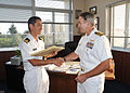 US Navy 090826-N-4031K-013 Capt. Eric Gardner, commanding officer of Naval Air Facility (NAF) Atsugi presents a certificate of appreciation to Lt. Shingo Okazaki, liaison officer for Japan Maritime Self-Defense Force Fleet Air.jpg