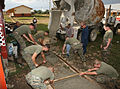 US Navy 091126-M-6217B-703 Marines assigned to the logistic command element of the Security Cooperation Marine Air-Ground Task Force pour and smooth concrete for new sidewalks at Garden City Primary School in Belmopan, Belize.jpg