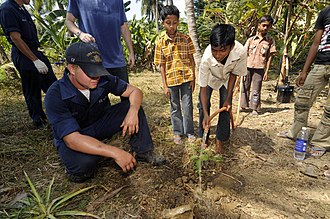 Ramakrishna Mission - Image: US Navy 100324 N 8335D 148 Mineman Seaman Derek Smith helps a boy from the Ramakrishna mission, an orphanage in Port Blair, plant a tree. Smith was one of 16 Sailors assigned to the mine countermeasures ship USS Patriot (MCM 7)