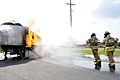 US Navy 100601-N-2468S-001 Firefighters assigned to Naval Construction Battalion Center Gulfport put out a fire during a semi-annual live aircraft fire training exercise.jpg