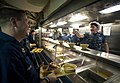 US Navy 100626-N-5319A-038 Senior Chief Boatswain's Mate Scott Wasserman jokes with Personnel Specialist 1st Class Christopher Miller in the chow line.jpg