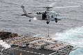 US Navy 100909-N-0232G-101 An MH-60S Sea Hawk helicopter lifts ordnance off the deck of the Military Sealift Command fast combat support ship USNS.jpg