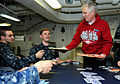 US Navy 110206-N-6632S-624 U.S. Rep. Mo Brooks (R-Ala.) passes out cookies donated by various schools to Sailors aboard the aircraft carrier USS Ge.jpg