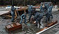 US Navy 110403-N-8607R-246 Sailors clean up debris from a harbor in Oshima, Japan.jpg