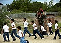 US Navy 110524-N-NY820-492 Senior Chief Master-at-Arms Gerald Rainford plays with kids at a school in Manta, Ecuador, during a community service ev.jpg