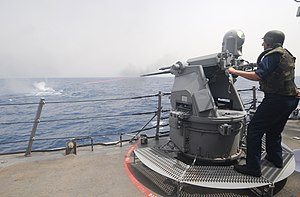 Typhoon Weapon Station - Image: US Navy 110722 N XQ375 242 Gunner's Mate 3rd Class Travis Hoffman fires a MK 38 25mm machine gun during a gun exercise aboard the guided missile de