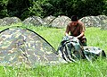 US Navy 110723-N-SD610-010 Chief Warrant Officer David Segura assembles his tent combat one person during Operation Bearing Duel.jpg
