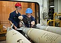US Navy 110812-N-DX615-158 Aviation Ordnanceman 2nd Class Nadezda Coe tightens the tail assembly of a GBU-38 joint direct attack munitions 500-poun.jpg