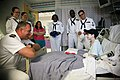 US Navy 111025-N-YM440-250 Cmdr. Tom Kait, commanding officer of the amphibious transport dock ship USS San Antonio (LPD 17) visits a patient at Me.jpg