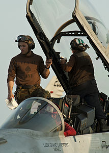 US Navy 120105-N-BT887-108 Sailors clean the canopy of an F-A-18F Super Hornet from the Black Aces of Strike Fighter Squadron (VFA) 41 aboard the N.jpg
