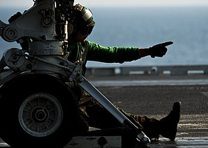 US Navy 120112-N-BT887-071 Aviation Boatswain's Mate (Equipment) 3rd Class Alfred Ranili gives the approval to add tension aboard the Nimitz-class.jpg