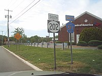 Two shields reading south Route 202 and south Morris County 511