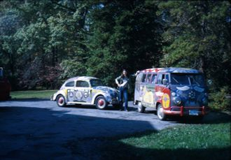 "Robert Richard Hieronimus - Musician Bob Grimm beside the Woodstock VW ""Light"", painted by Bob Hieronimus."