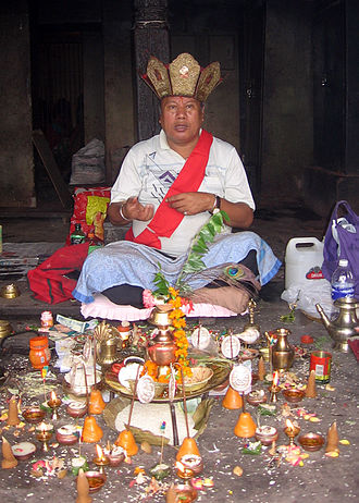 Priest - A vajracharya (thunderbolt-carrier), a Newar Buddhist priest.