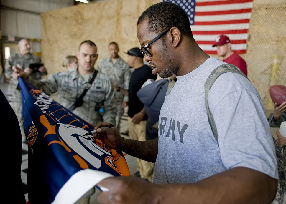 Von Miller signing autographs at Transit Center Manas-March 2013