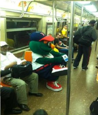 Wally the Green Monster - Wally 'Behind Enemy Lines' riding the Subway in NYC on a trip to the MLB FanCave