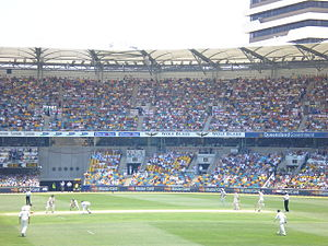 Shane Warne - Warne (right) bowling to Ian Bell at Brisbane Cricket Ground in 2006.