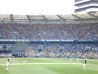 Shane Warne - Warne (right) bowling to Ian Bell at The Gabba in 2006.