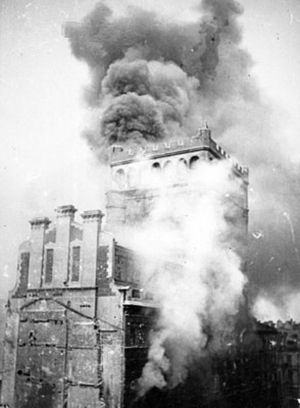 Warsaw Uprising: View of burning PAST-a buildi...