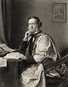 engraving of portrait of middle aged man  sitting at desk, wearing  doctoral robes, clean shaven but with long sideboards, looking out at viewer,
