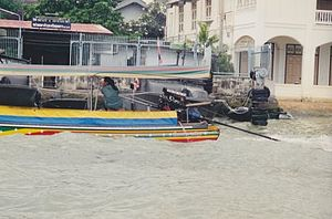 Woman at the sail in a boat in Bangkok Thailand.jpg