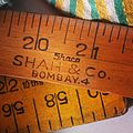 Wooden ruler used for measuring cloth in a Bangalore tailor shop.jpg