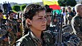 YPJ fighter with her rifle barrel pointed up.jpg