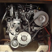 a yanmar 2gm20 marine diesel engine, installed in a sailboat  the center  pulley is the crankshaft, the lower left one the seawater pump, the upper  right one