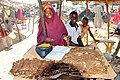 Young girl selling dried meat.jpg