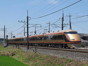 "Tobu 100 series - Set 106 in ""Nikko Moude Spacia"" gold and black livery, July 2015"