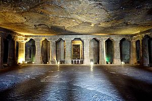 Vihara - 5th century Cave 4 at the Ajanta Caves with a Buddha statue in the centre shrine cell.