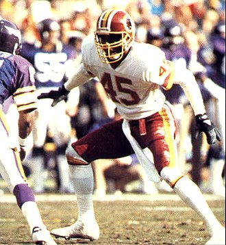 1987–88 NFL playoffs - Redskins cornerback Barry Wilburn defending an opponent of the Minnesota Vikings during the NFC Championship Game.