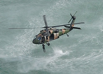 1st Commando Regiment (Australia) - A Commando helocasting from a Black Hawk helicopter into Shoalwater Bay during Exercise Talisman Saber 2013